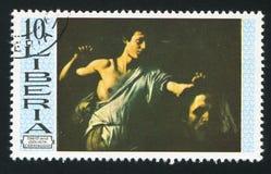David and Goliath by Caravaggio. LIBERIA - CIRCA 1969: stamp printed by Liberia, shows David and Goliath by Caravaggio, circa 1969 Stock Photos