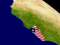 Liberia with flag on Earth Stock Photo
