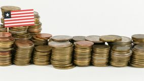 Liberia flag with stack of money coins. Liberia flag waving with stack of money coins stock video