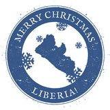 Liberia map. Vintage Merry Christmas Liberia. Liberia map. Vintage Merry Christmas Liberia Stamp. Stylised rubber stamp with county map and Merry Christmas text Royalty Free Stock Photography