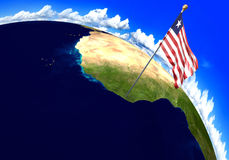 Liberia national flag marking the country location on world map. 3D rendering, parts of this image furnished by NASA Royalty Free Stock Images