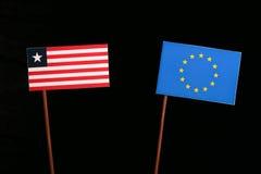 Liberian flag with European Union EU flag  on black Royalty Free Stock Images