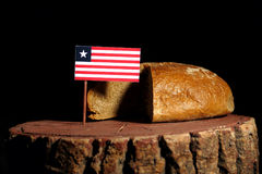Liberian flag on a stump with bread.  Stock Photos