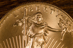 Liberity (Word) on United States walking Liberty Gold Coin stock photos