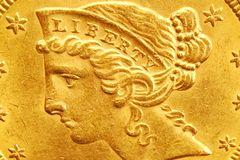 Liberty. Head detail from a US five dollar gold coin Stock Photos