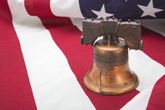 Liberty bell American flag patriotic. The liberty bell on the USA freedom flag creates a colorful background Stock Photos