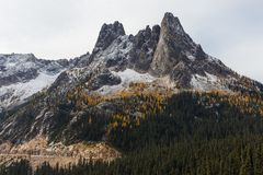 Liberty Bell Mountain Autumn Landscape. View of Liberty Bell Mountain from Washington Pass Overlook during the Autumn Season with early dusting of snow Stock Images
