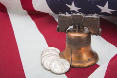 Liberty bell silver coins American flag success Stock Image