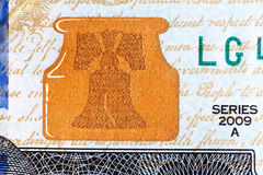 Liberty Bell U.S. currency one hundred dollar bill. Royalty Free Stock Photography