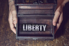Liberty box. Man hands on the box, which shows independence Royalty Free Stock Images