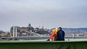 Liberty Bridge. BUDAPEST, HUNGARY, MARCH 25, 2017 - Liberty Bridge - Young couple sitting on the Liberty Bridge, enjoying the view Stock Photos