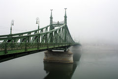 Liberty Bridge Budapest. The iconic Liberty Bridge in Budapest in a typical autumnal foggy day Stock Photo