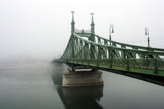 Liberty Bridge Budapest. The iconic Liberty Bridge in Budapest in a typical autumnal foggy day Royalty Free Stock Photos