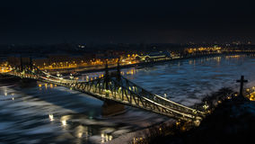 Liberty Bridge - Budapest. Landmark of Budapest - Liberty Bridge at night, the danube is full of drift ice Stock Image