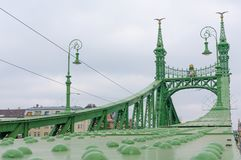 Liberty Bridge or Freedom Bridge in Budapest, Hungary, connects Buda and Pest across the River Danube.  stock photos