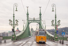 Liberty Bridge or Freedom Bridge and tram in Budapest Royalty Free Stock Image