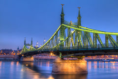 The Liberty Bridge in Hungary. Blue hour photo of the famous Liberty Bridge in Budapest, Hungary in evening lights Stock Image