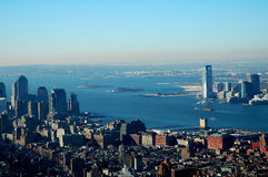 Liberty in the distance. Statue of liberty seen from top of Empire State building Stock Photos