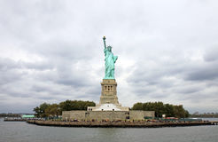 Liberty Island in New York. The liberty island with the freedom statue ant a storm coming Royalty Free Stock Image