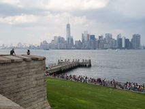 Liberty Island with Manhattan skyline on the background Royalty Free Stock Images