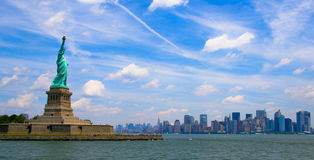 Liberty and Manhattan. Liberty island with Statue of Liberty, and the Manhattan skyline royalty free stock photo