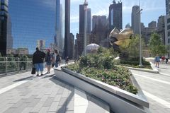Liberty Park. An elevated public park at the World Trade Center in New York City. It contains The Sphere, a sculpture recovered from the rubble after the stock photo