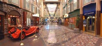 Liberty of the Seas cruise ship interior. Royal Promenade, inside the ship deck with shops, bars and dining venues, Liberty of the Seas cruise ship interior Stock Image