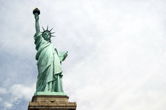 Liberty Statue. Closeup with clouds in the background in a sunny day - New York USA 2007 royalty free stock photography