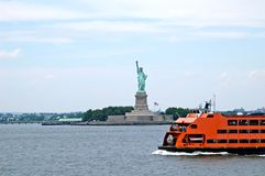 Liberty statue and the ferry. A view of liberty statue and the ferry royalty free stock images