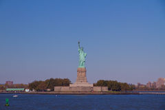 The Liberty Statue. Liberty Statue holding the torch, standing on Liberty Island surrounded by sea water Stock Image