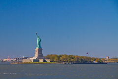 The Liberty Statue. Liberty Statue holding the torch, standing on Liberty Island surrounded by sea water Stock Photography