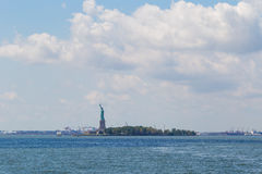The Liberty Statue. Liberty Statue holding the torch, standing on Liberty Island surrounded by sea water Royalty Free Stock Photography