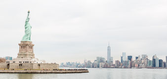 Liberty statue and New York skyline Stock Image
