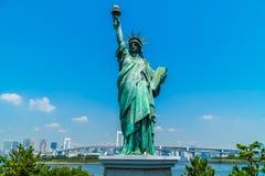 Liberty statue with rainbow bridge in odaiba island. Tokyo japan stock photography
