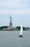 Liberty statue and ship. A view of liberty statue and ship stock image