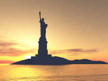 Liberty Statue silhouette. Over sunset Royalty Free Stock Photos