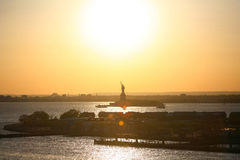 Liberty Statue silhouette at sunset Royalty Free Stock Photos