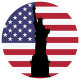 Liberty statue and usa flag Stock Image