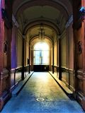 Liberty style building `s entrance, art, history and light in Turin city, Italy. Woodden door, corridor, lamp, arches, decoration, bright enchanting details stock photos