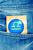 Libra. Astrology card with zodiac sign of libra in a blue jeans pocket Stock Image