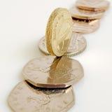 Libra britânica e moedas de um centavo Fotos de Stock Royalty Free