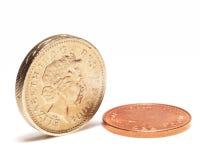 Libra e moeda de um centavo Foto de Stock Royalty Free