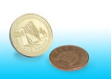 Libra e moeda de um centavo Fotografia de Stock