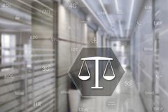 LIBRA with the security shield on the touch screen with a blur background of the office.The concept of justice .Business, security. Internet, court, Tribunal Stock Photos