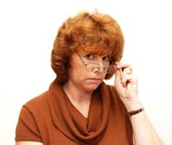 Librarian. A women who is looking over her glasses like a librarian Royalty Free Stock Images
