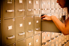 Librarian checking index cards. Librarian looking through old-fashioned index cards cabinet Stock Photography