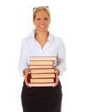 Librarian holding pile of books. European librarian holding pile of books. All on white background Stock Photos