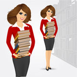 Librarian holding stack of books Stock Photography