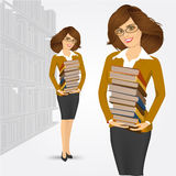 Librarian holding stack of books Stock Images