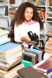 The librarian. Library, young smiling librarian, book labels Royalty Free Stock Photos